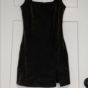 Tight fitting black with gold glitter dress